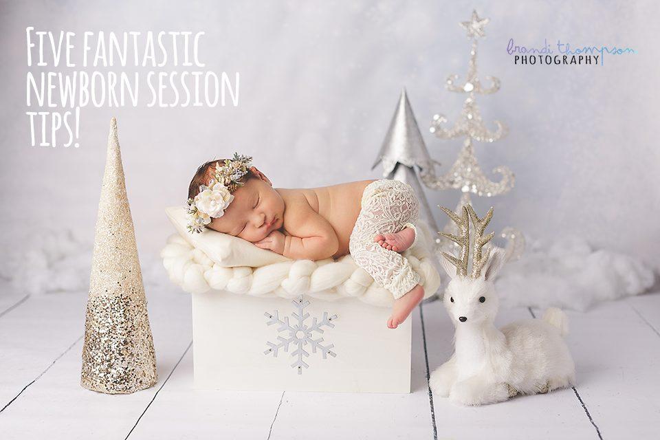 newborn photography - baby girl in white pants sleeping in a winter scene in plano, studio