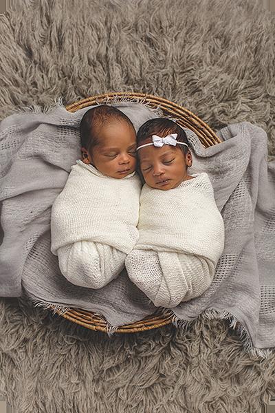 twin newborn babies sleeping